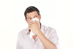 De mens van het niesgeluid stock foto