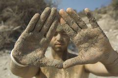 De mens van het zand Stock Foto's