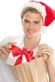 De mens van Kerstmis met zak stock foto