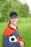De mens van Smilling met voetbalbal Royalty-vrije Stock Foto