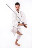 De mens van vechtsporten met zwaard stock afbeeldingen