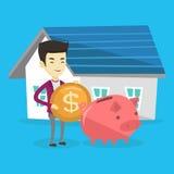 De mens zet geld in spaarvarken voor het kopen van huis Stock Foto