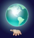 De menselijke hand houdt een aarde stock illustratie