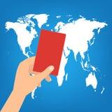 De menselijke hand houdt een rode kaart op de achtergrond van de wereldkaart Vectorillus Stock Foto's