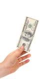 De menselijke hand met geld isoleert op wit Royalty-vrije Stock Afbeeldingen