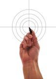 De menselijke hand trekt doel Stock Foto's