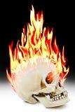 De menselijke schedel die in de brand branden royalty-vrije stock afbeelding