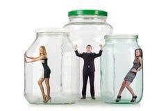 De mensen in de glaskruik die worden opgesloten stock afbeelding