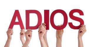 De mensen houden vaarwel Rechte Spaanse Adios-Middelen Stock Afbeeldingen