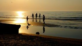 De mensen silhouetteren Stock Foto's