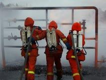 De mensen van de brand in actie Stock Foto