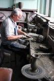 De mensen van de pottenbakker het werken Stock Foto