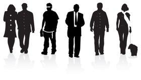 De mensen van het silhouet het lopen Stock Foto's