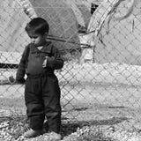 De mensen in vluchteling kamperen Royalty-vrije Stock Afbeeldingen