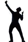 De mensen volledige lengte die van het silhouet aan muziek luistert stock fotografie