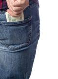 De mensenhand neemt een pak dollars uit zijn zak Stock Fotografie