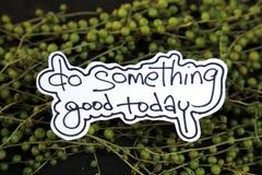 De met de hand geschreven woorden doen vandaag Goed iets Stock Foto