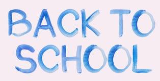 De met de hand geschreven Blauwe Tekst van het Waterverfbericht terug naar School op Wit stock foto's