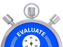 De metaalchronometer met woord evalueert Stock Afbeeldingen