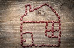 de metafoor van het ecohuis van rode bonen Royalty-vrije Stock Afbeeldingen