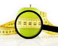 De meter en het vergrootglas van de appel Royalty-vrije Stock Afbeeldingen