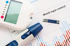 De meting van de bloedsuiker stock foto's