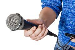 De microfoon van de vrouwenholding Royalty-vrije Stock Afbeelding