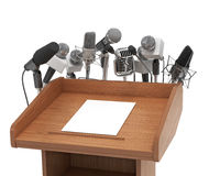 De microfoons van de conferentievergadering met tribune Royalty-vrije Stock Afbeelding