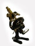 De microscoop van het brons stock foto's