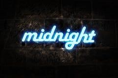 De Middernacht van het Teken van het neon Stock Afbeeldingen