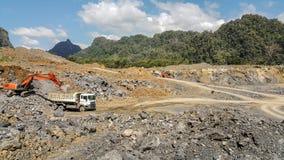 De mijnbouw is de extractie van waardevolle mineralen van de aarde Stock Fotografie