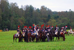 De militairen berijden paarden Stock Afbeeldingen