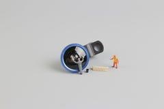 de mini schoonmakende camera van de mensenarbeider len Stock Afbeelding