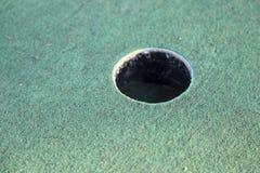 De miniatuurkop van de Golfcursus Stock Afbeeldingen