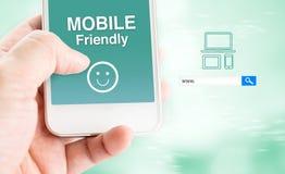 De mobiele telefoon van de handaanraking met mobiel vriendschappelijk woord met onderzoek BO Stock Afbeelding