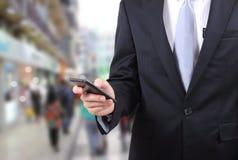 De mobiele telefoon van de mensenaanraking Stock Foto