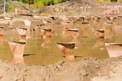 De modderkuil bij een modder stelt hinderniscursus in werking Stock Afbeelding
