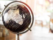 De moderne uitstekende bol van de stijl zwarte aarde stock foto's