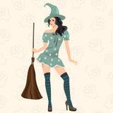De modieuze heks met een veger Stock Foto's