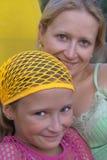 De moeder van Smilling met dau Stock Foto