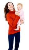 De moeder wordt gespeeld met een kleine baby, een gelukkige familie Royalty-vrije Stock Foto's