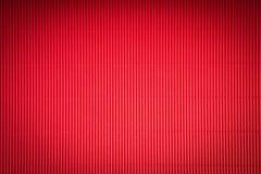 De mooie achtergrond van de Valentijnskaartendag met rood geribbeld document stock fotografie