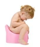 De mooie baby kijkt in roze onbenullig Royalty-vrije Stock Foto