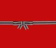 De mooie bruine boog van de lintgift met stippen Stock Foto