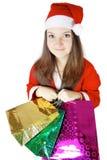 De mooie dame kleedde zich aangezien de Kerstman met voorstelt Royalty-vrije Stock Foto