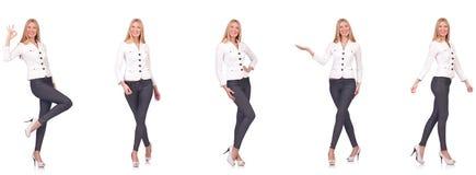 De mooie die vrouw in broeken op wit wordt geïsoleerd stock fotografie
