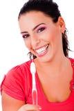 De mooie jonge tandenborstel van de vrouwenholding royalty-vrije stock foto's