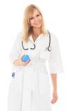 De mooie jonge verpleegster flirt met blauw klysma Royalty-vrije Stock Afbeelding