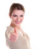 De mooie jonge vrouw die duim toont ondertekent omhoog Royalty-vrije Stock Afbeeldingen
