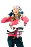 De mooie jonge vrouw gaat ijs-schaatst stock afbeelding